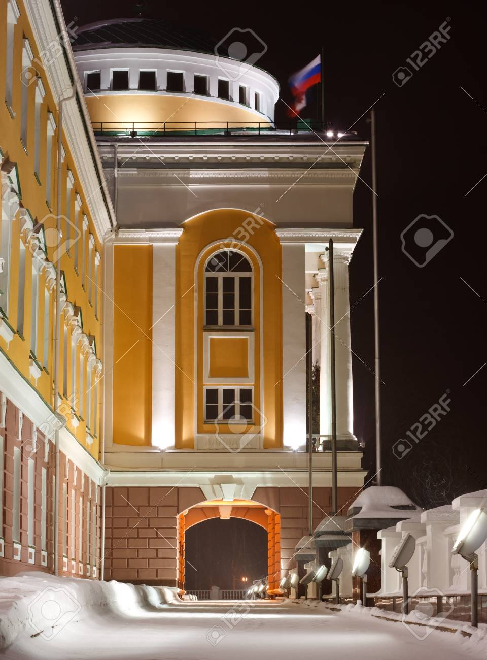 office building with an arch and flags at the night Stock Photo - 11748314