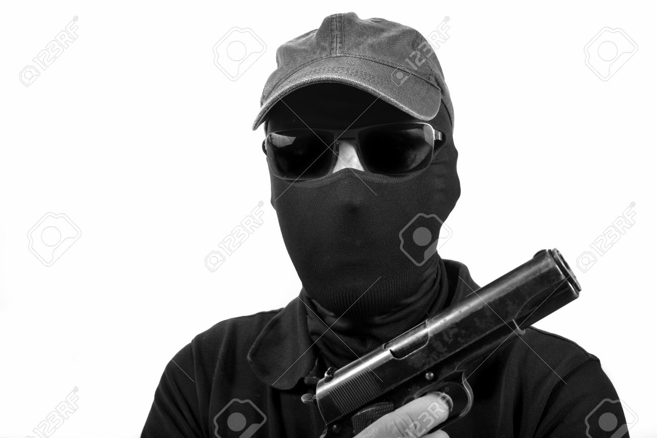 hooded man with a gun in black and white - 26086683