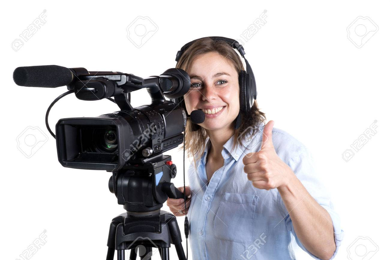 young woman with a video camera isolated on a white background - 28704552