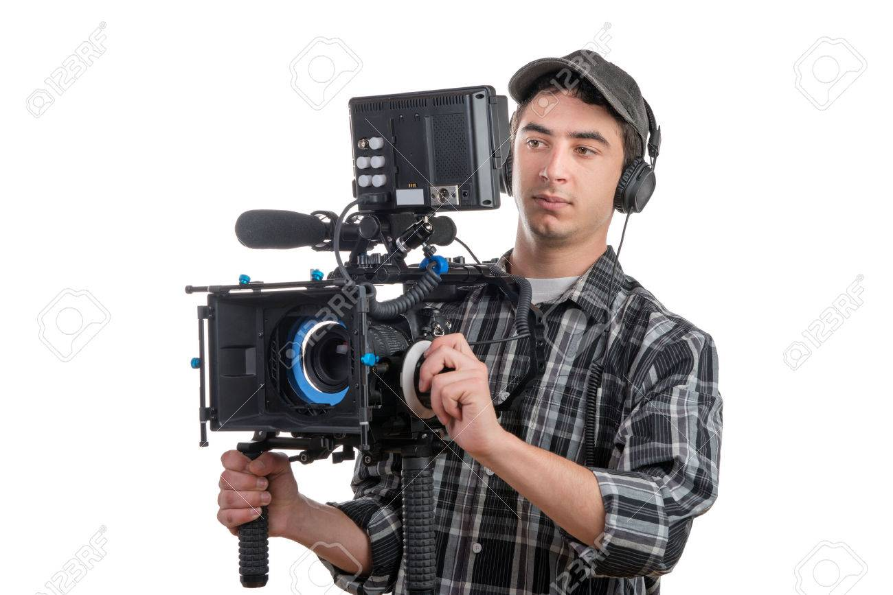 young professional cameraman and camera on the white background - 34794724