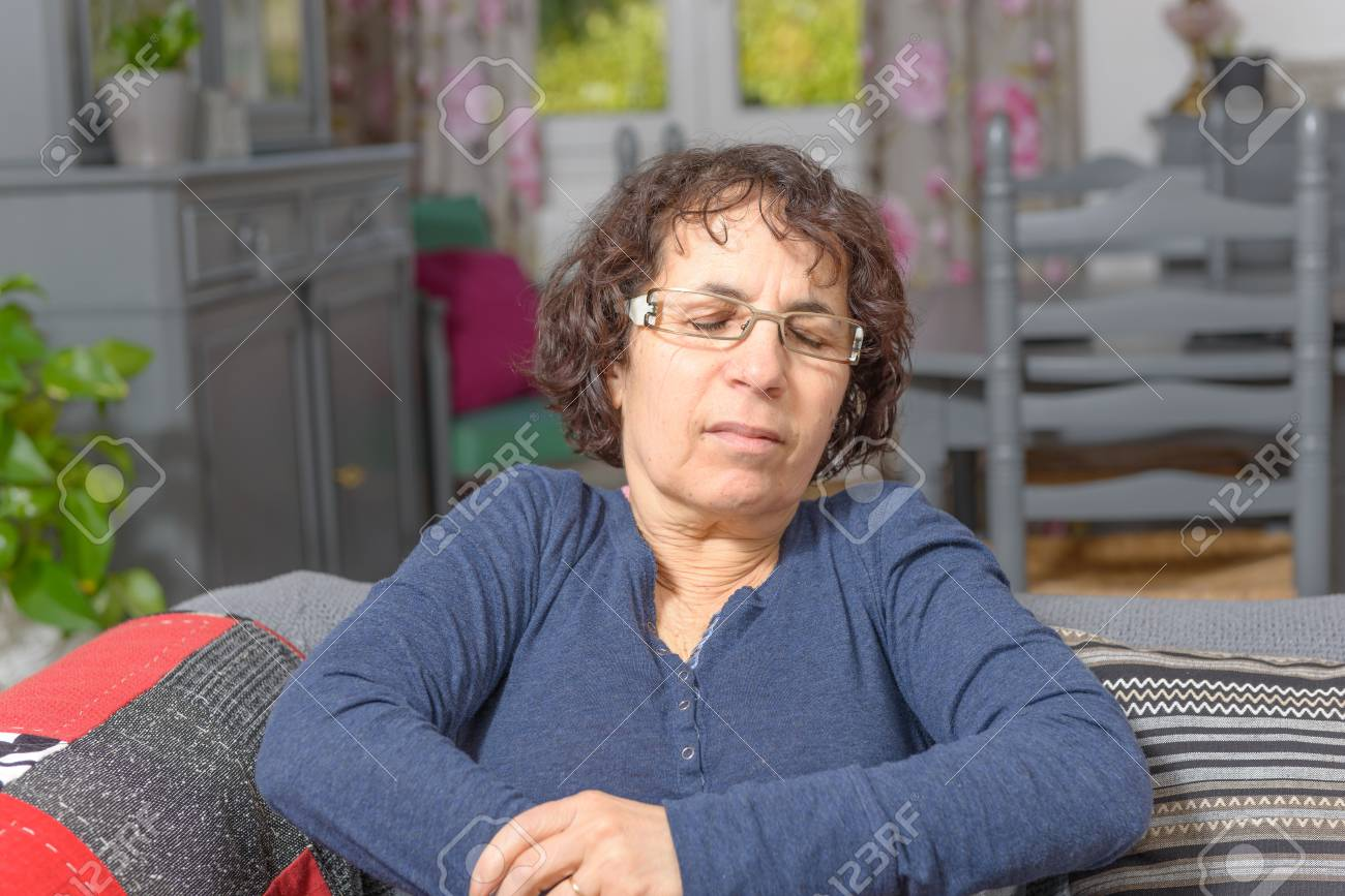 a middle-aged woman has a stomach ache - 38377940