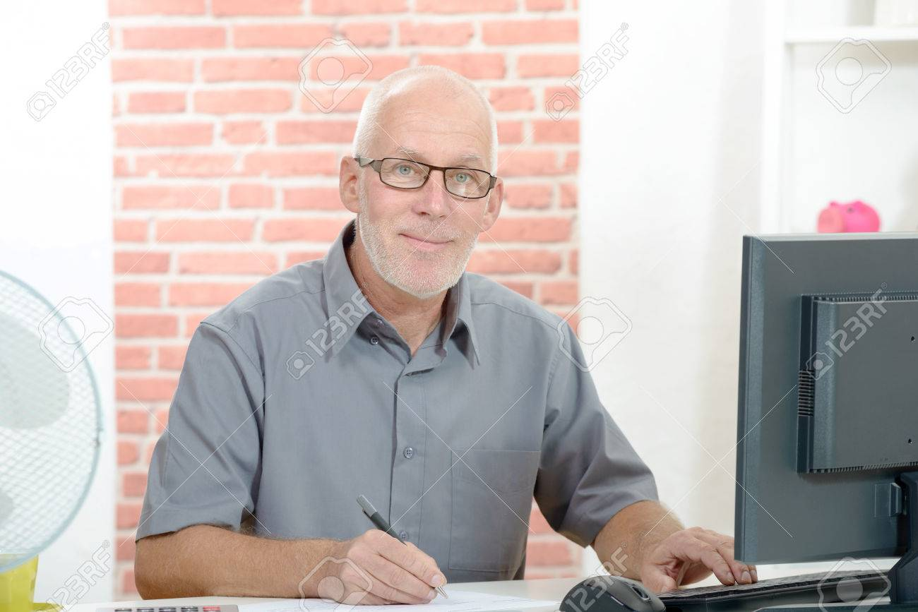 middle-age businessman working on computer in office - 46787193