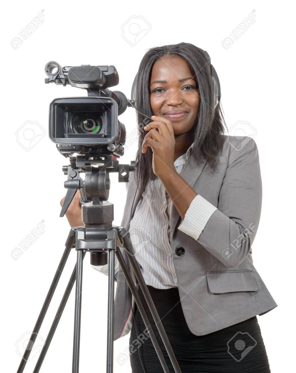 a young African American women with professional video camera and headphone  Stock Photo - 53886961 347111563f