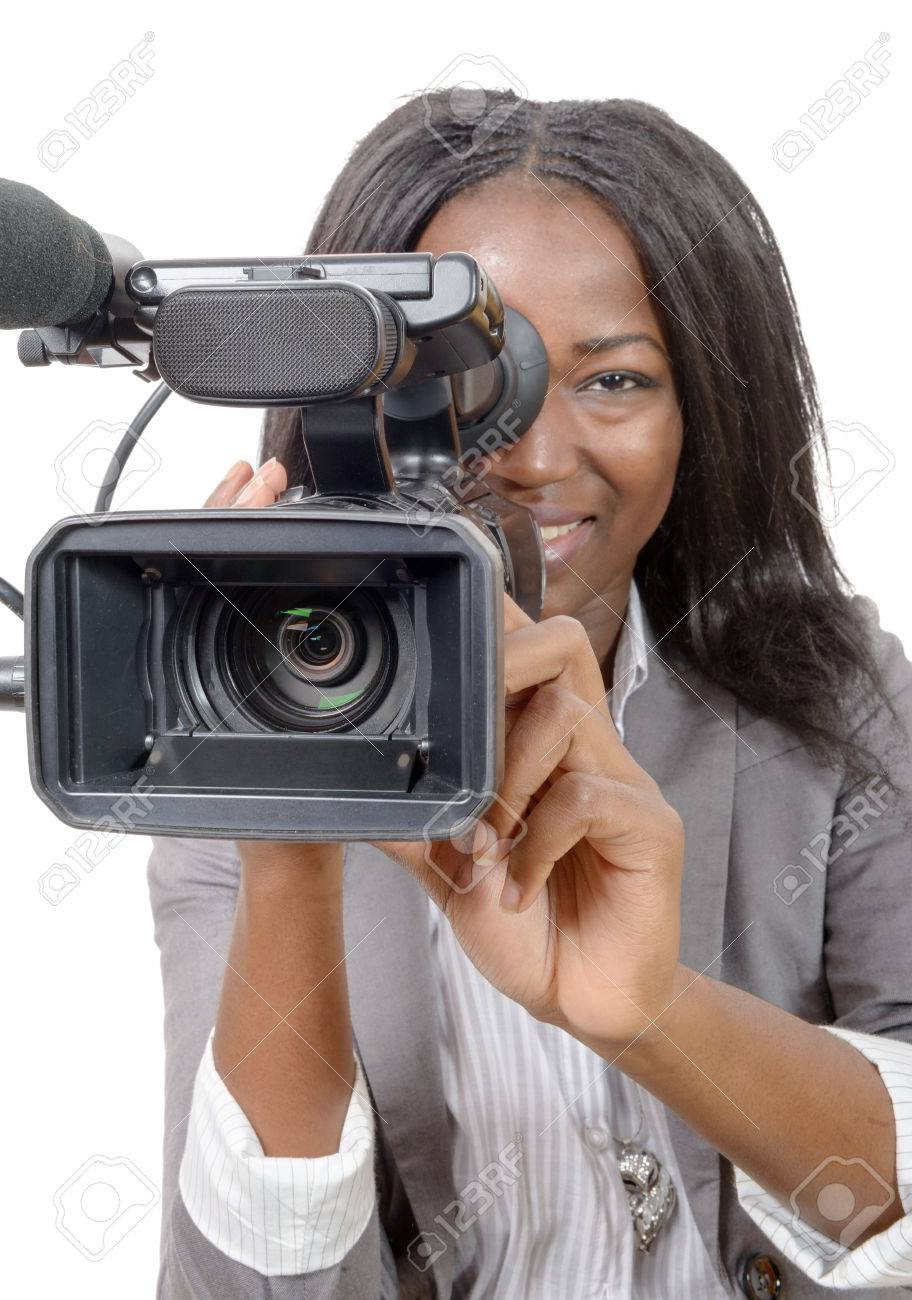 a young African American women with professional video camera on white background - 56426534