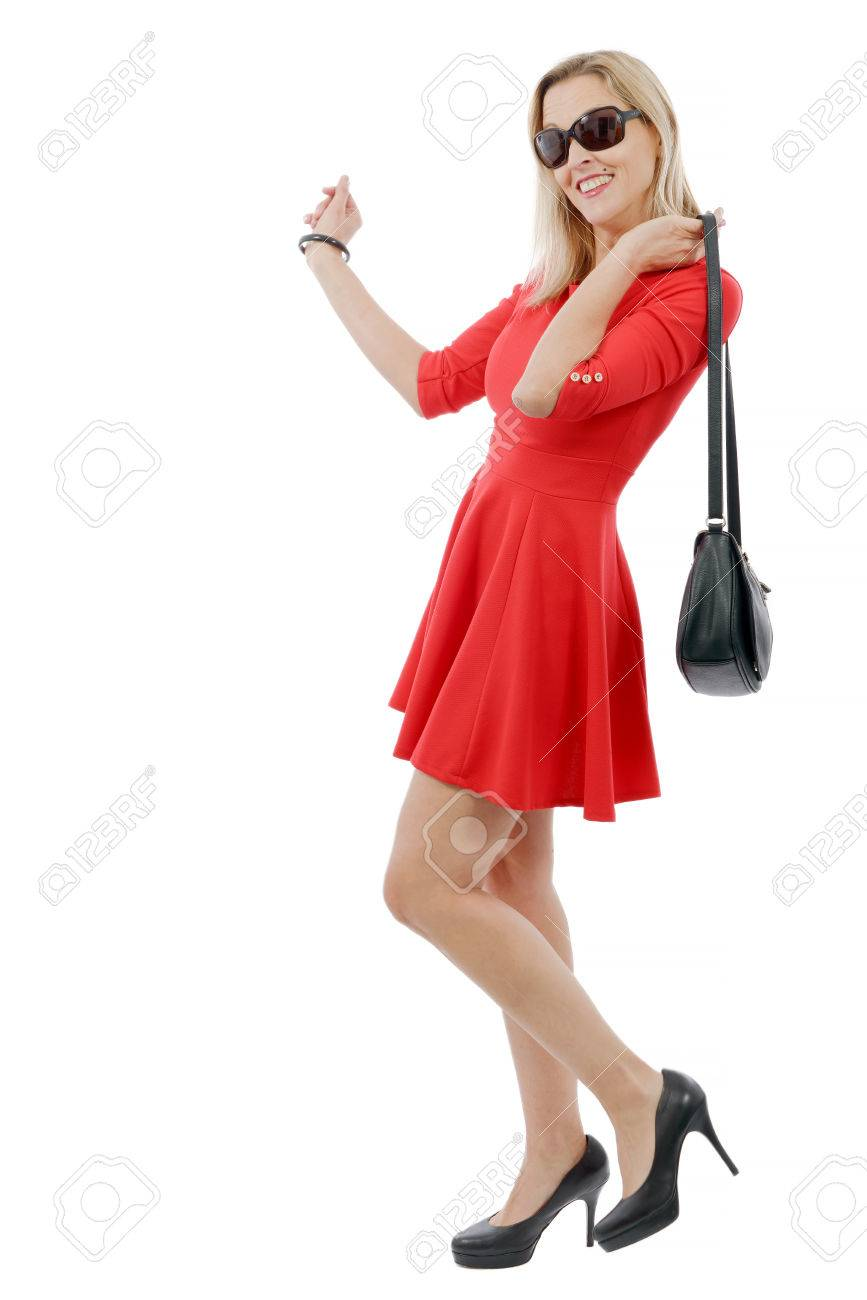 Full Figure Of Beautiful Blonde Woman In Short Red Dress Stock Photo