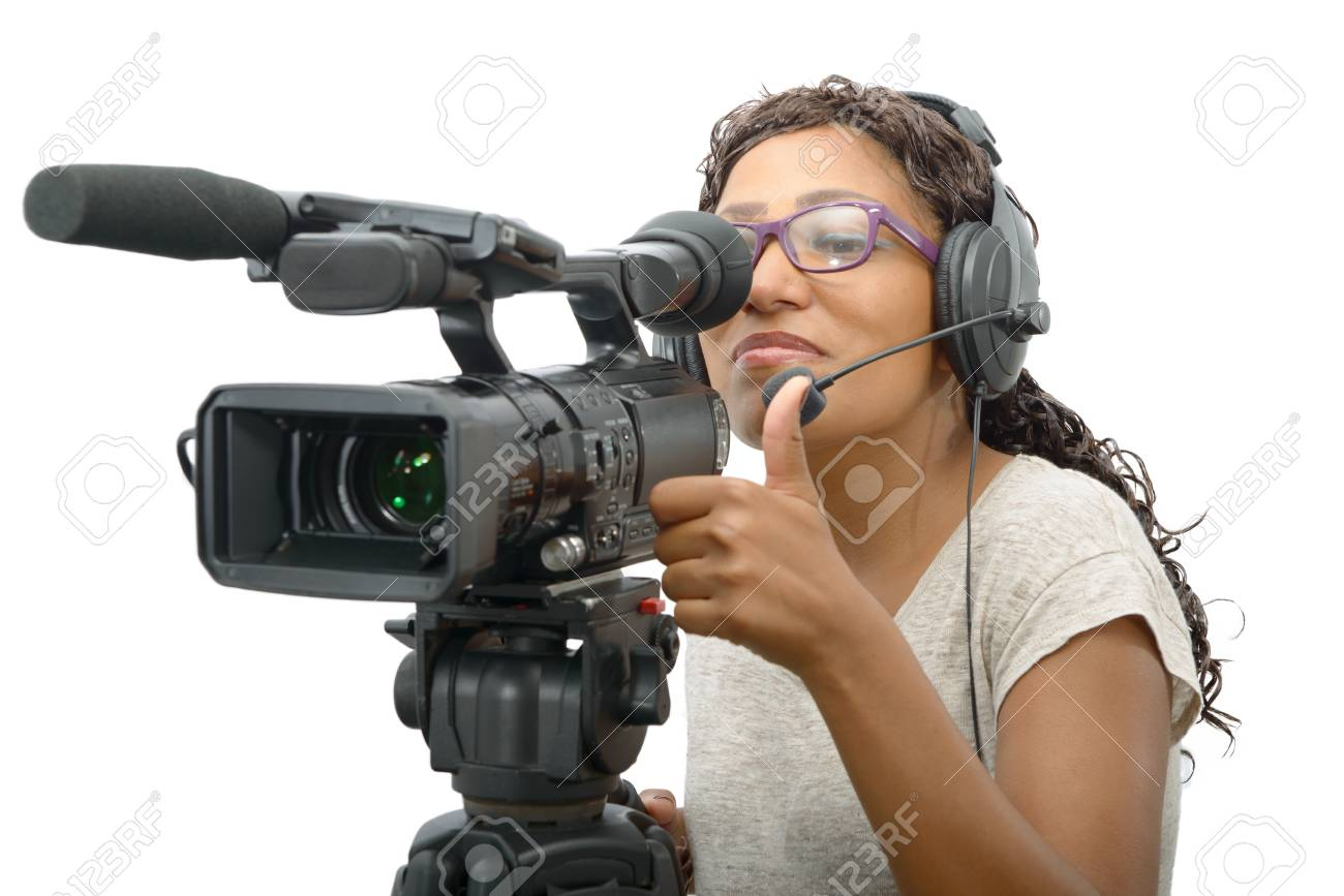 a young African American women with professional video camera and headphone  Stock Photo - 76553447 5b6b603b45