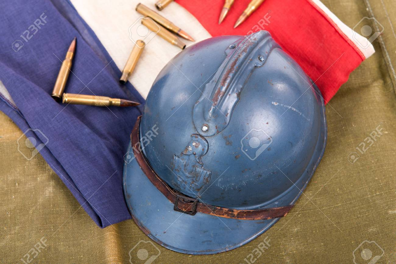 french military helmet of the First World War on a red white blue flag - 78418322