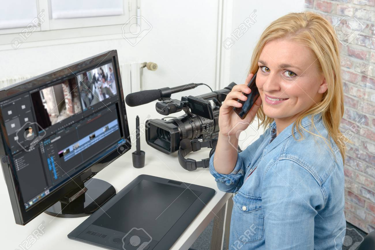 young blond woman designer using computer for the video editing - 86755075