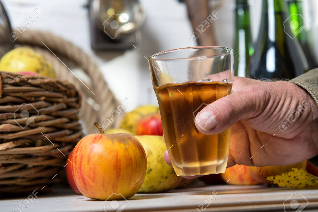 aa man with glass of cider, apples at background - 92252652