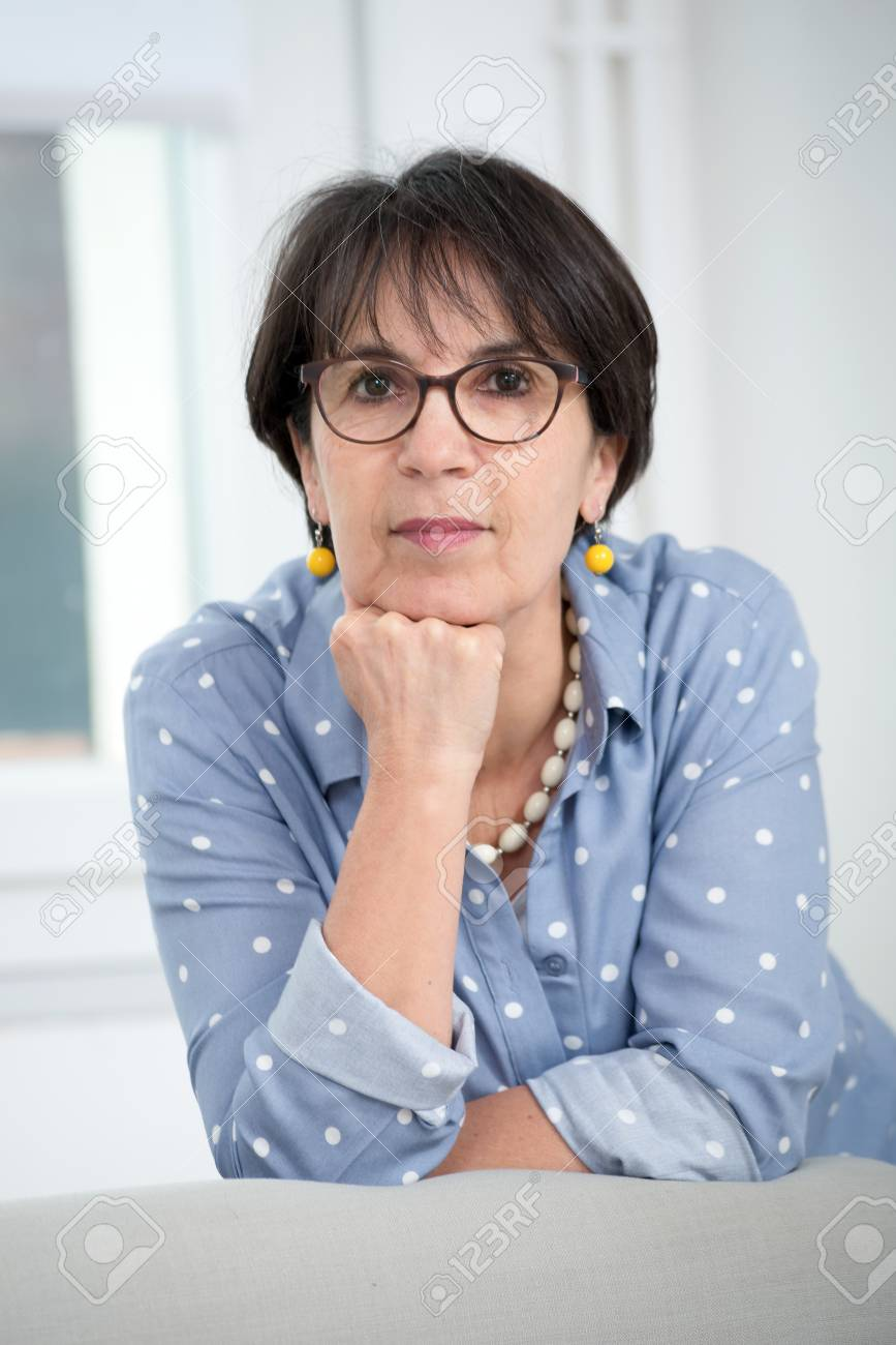 a portrait of middle age brunette with glasses - 95308393