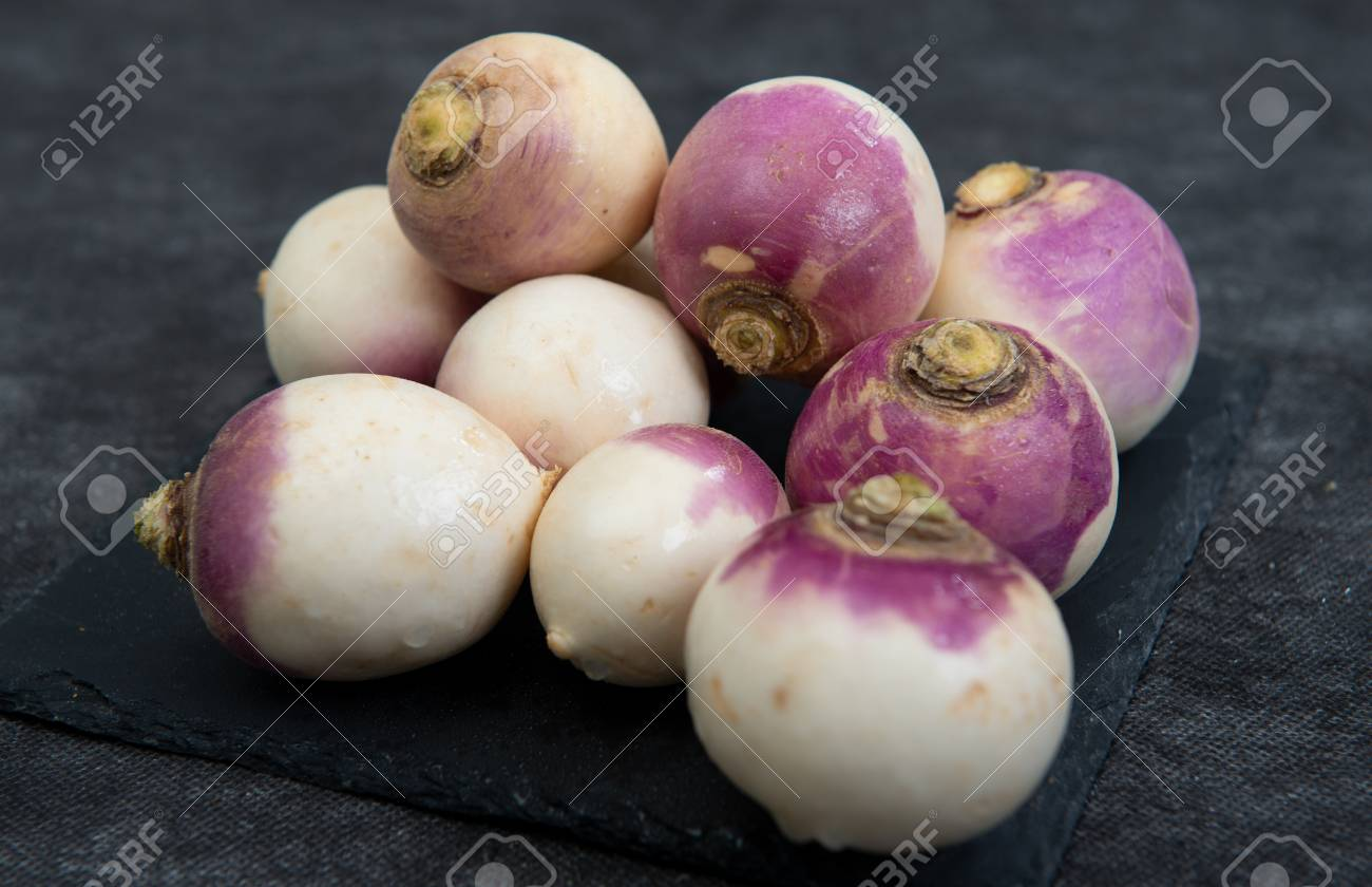 close up of group of organic turnips - 117663307
