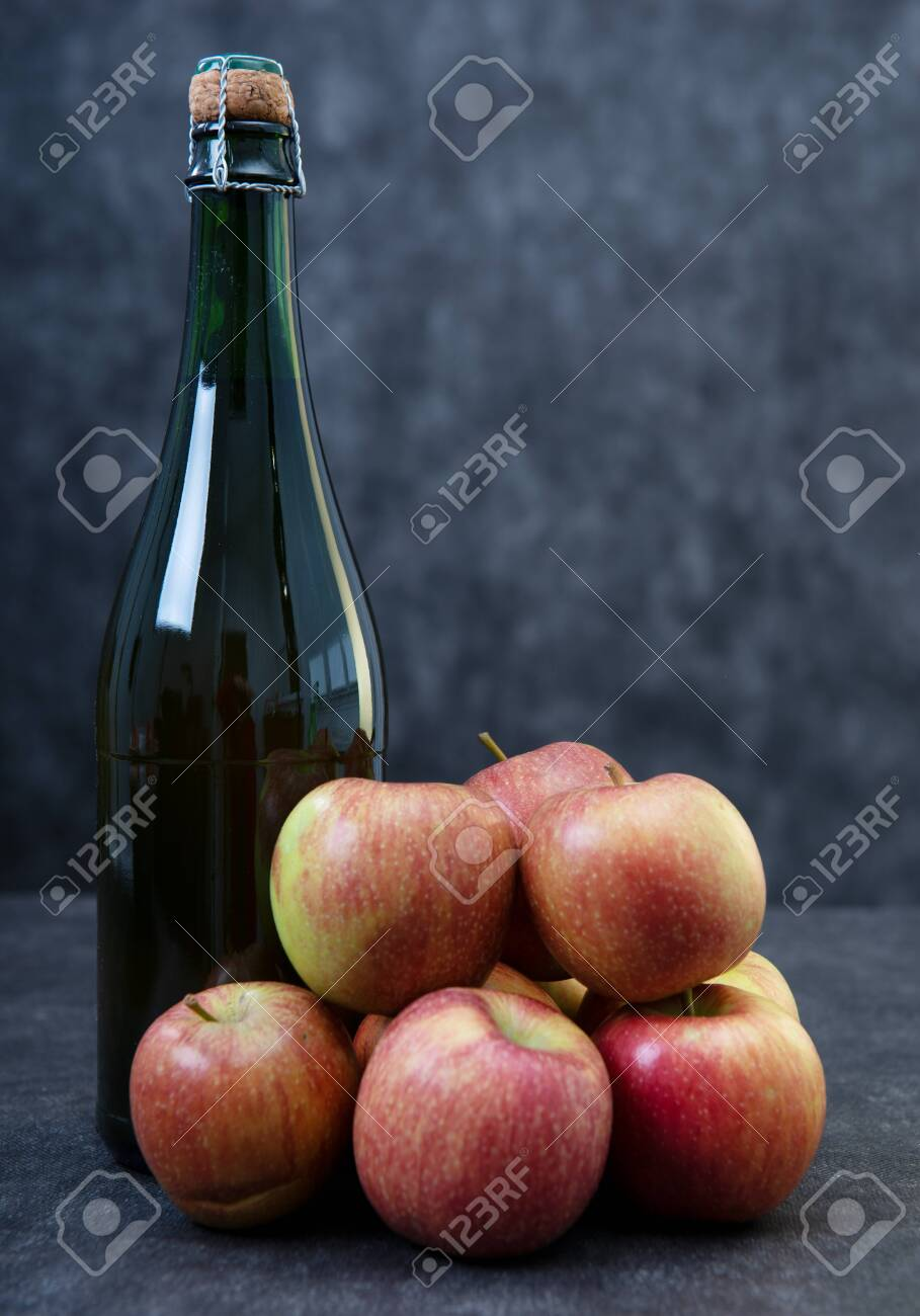 a bottle of cider and beautiful organic apples - 118228404
