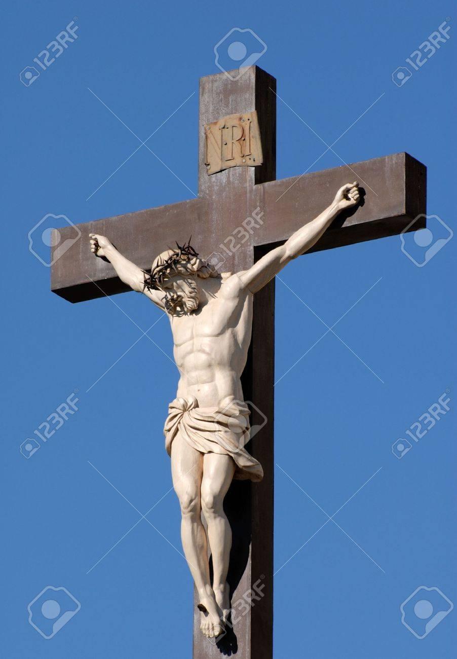 statue of jesus christ at cross in avignon france stock photo