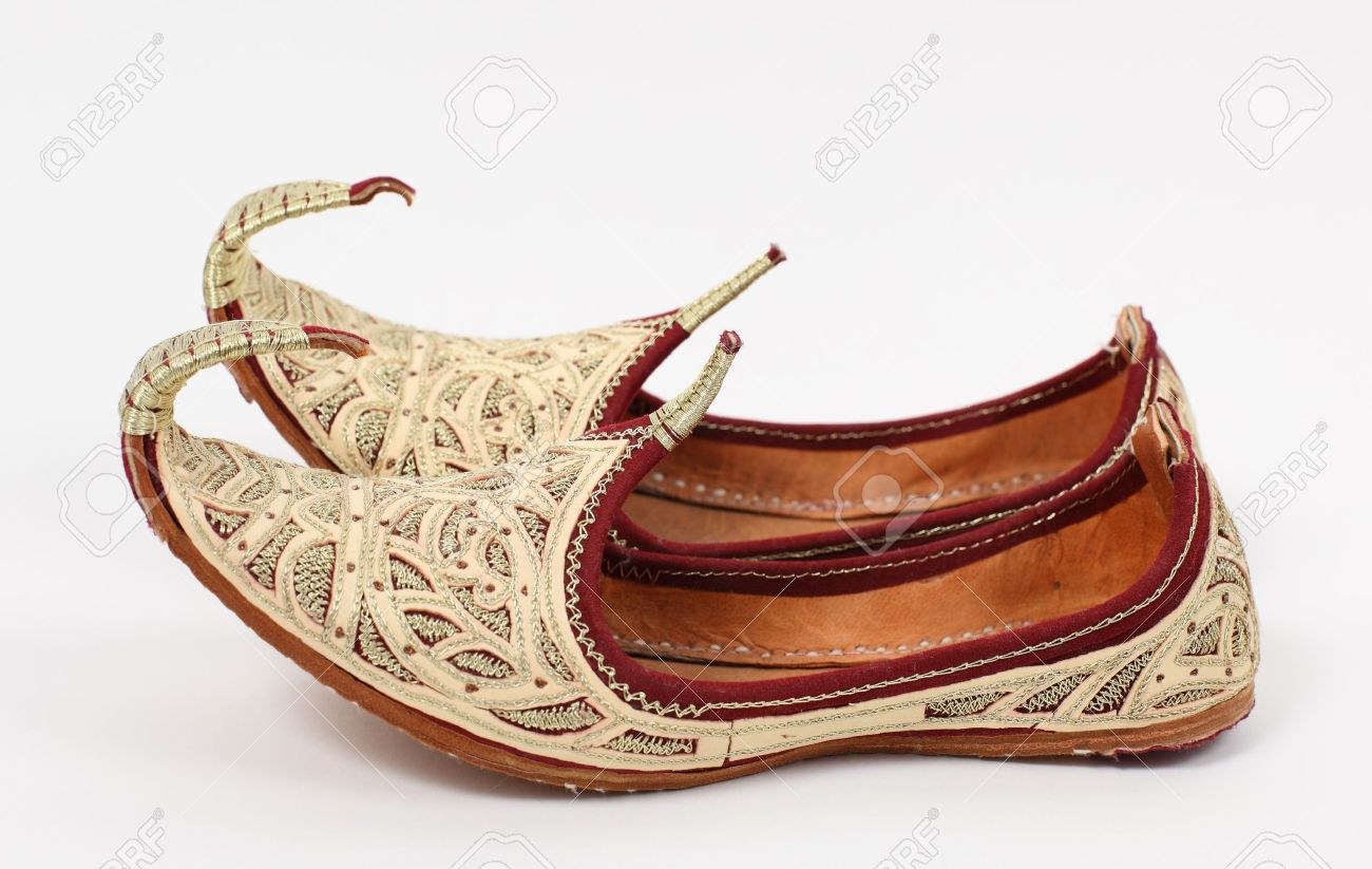 2360a6cba50 Stock Photo - Traditional Arabic shoes over white background