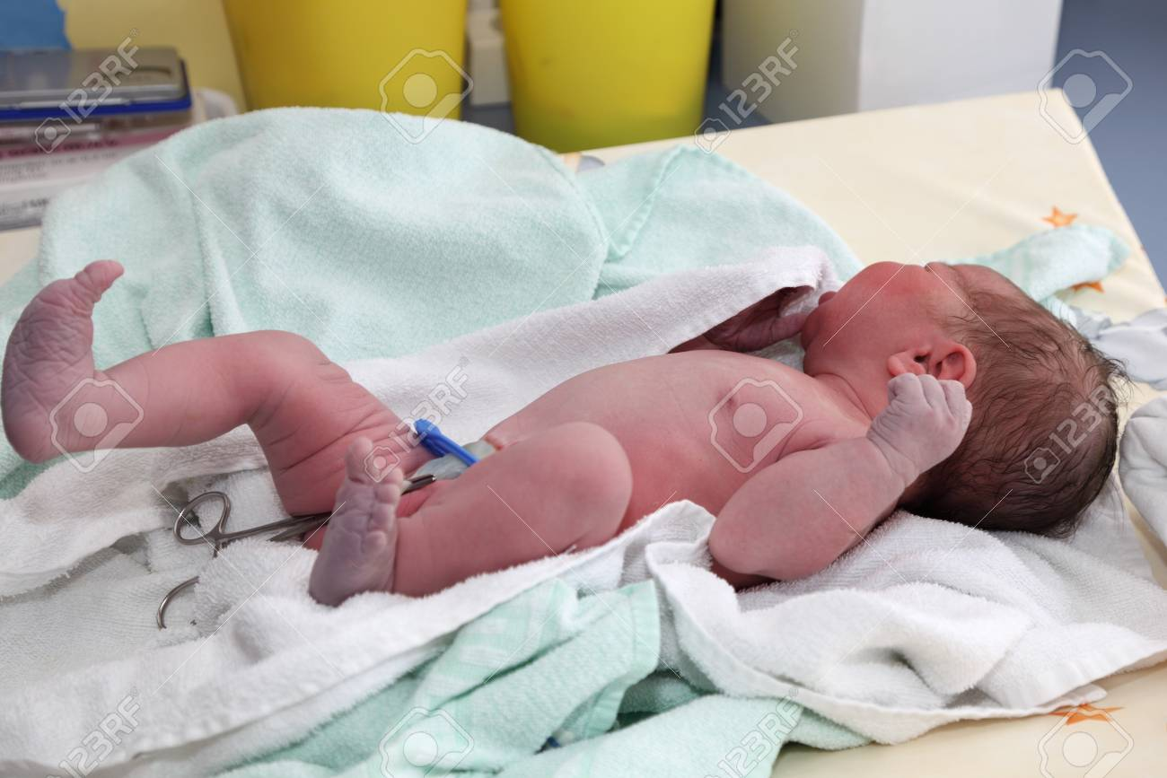 Newborn baby on table at hospital Stock Photo - 7908304