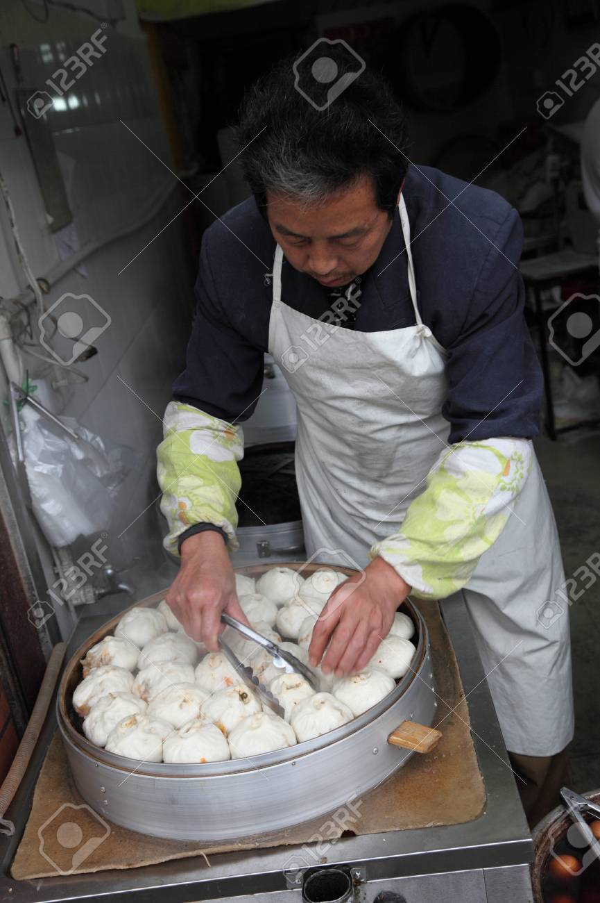 Traditional Chinese steamed bun seller in Shanghai, China. Photo taken at 16th of November 2010 Stock Photo - 8449308