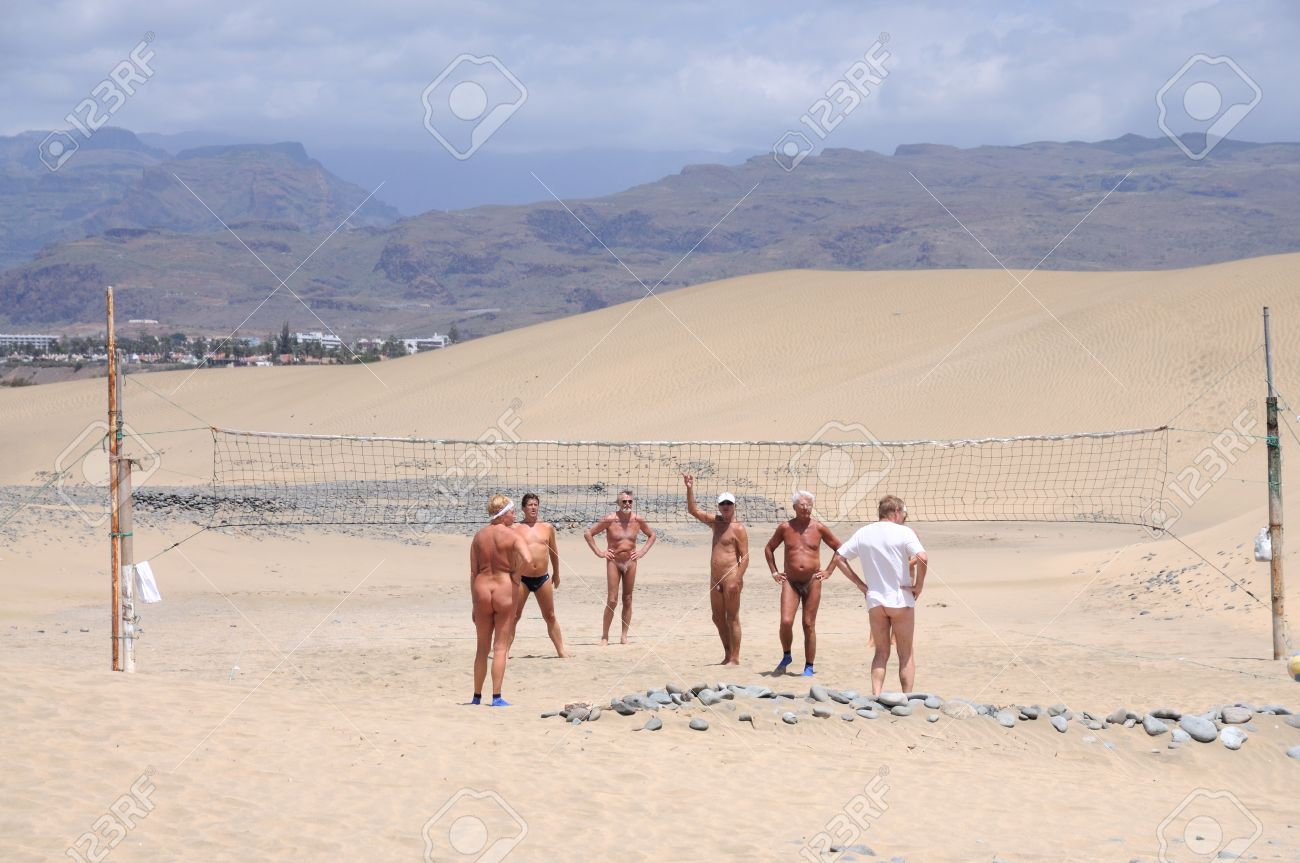Spain Nudists Nudists playing beach ball at the dunes of Maspalomas, Grand Canary Island,  Spain.