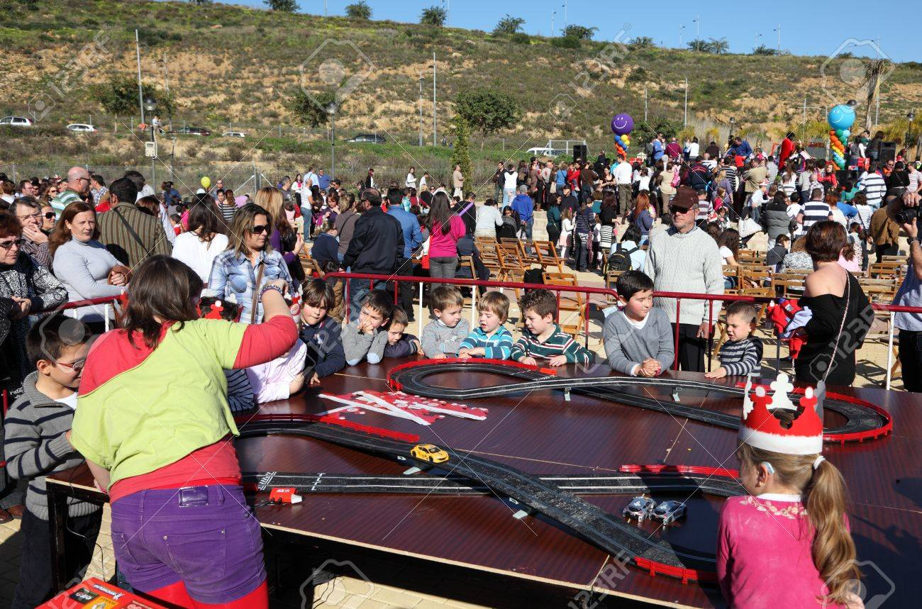 slot car race for kids at an outdoor party in estepona spain stock photo