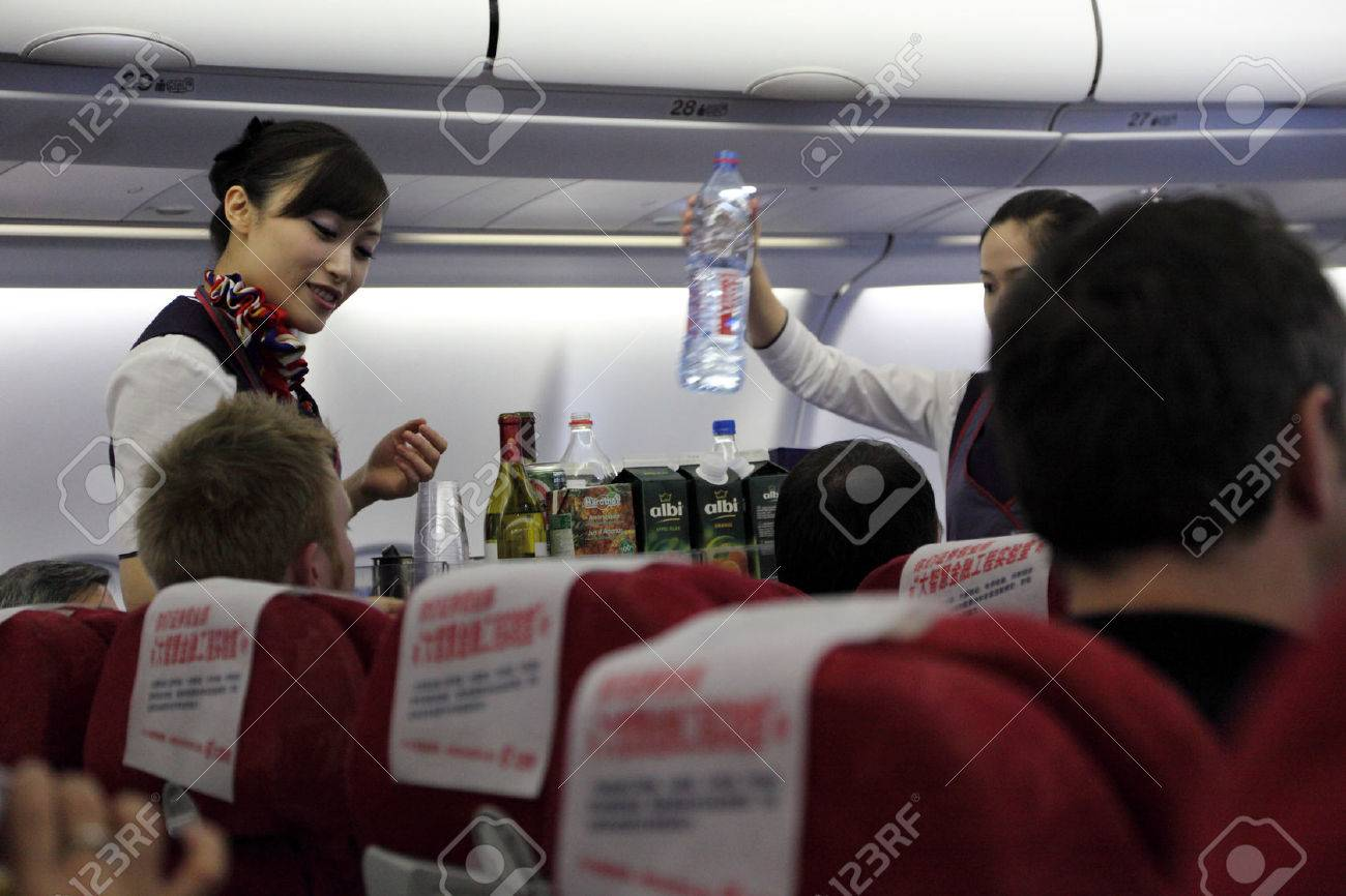 Stewardess serving lunch in China Eastern Airline flight Stock Photo - 22459743