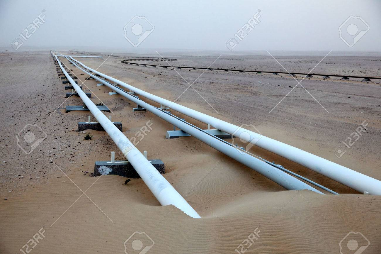 Oil pipeline in the desert of Qatar, Middle East Stock Photo - 24880587