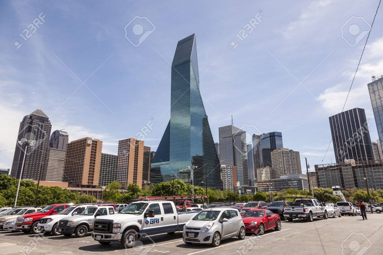 DALLAS, USA - APR 7: Wells Fargo Bank building and a parking lot in Dallas Downtown. April 7, 2016 in Dallas, Texas, United States - 57781115