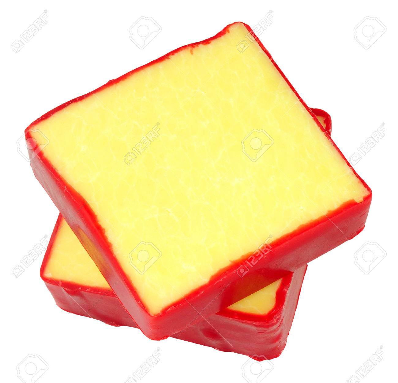 Monterey Jack cheese squares with red wax coating isolated on
