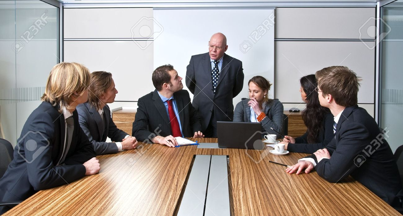 A company manager, and his team, discussing business strategies during an office meeting Stock Photo - 4251210