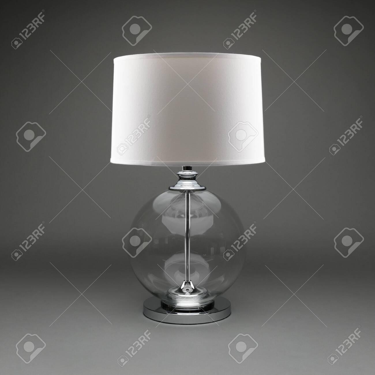 Image of: Individula Clear Glass Ball Table Lamp With White Lamp Shade On A Dark Grey Background Fotos Retratos Imagenes Y Fotografia De Archivo Libres De Derecho Image 129613528