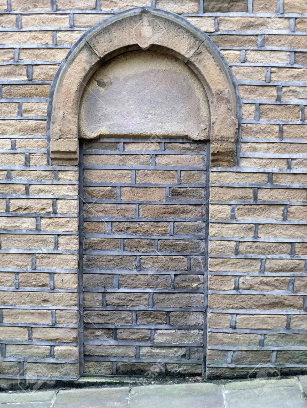 Ordinaire Bricked Up And Blacked Doorway In An Old Stone Building With Arch Over Door  Frame Stock
