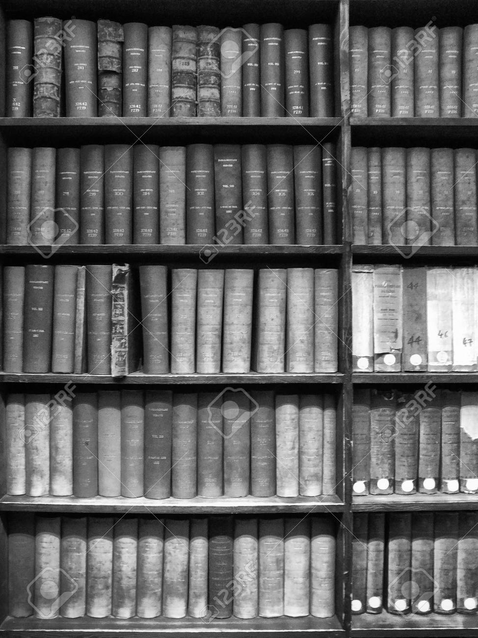 Old reference books stacked on wooden shelves stock photo picture old reference books stacked on wooden shelves stock photo 83015180 ccuart Images