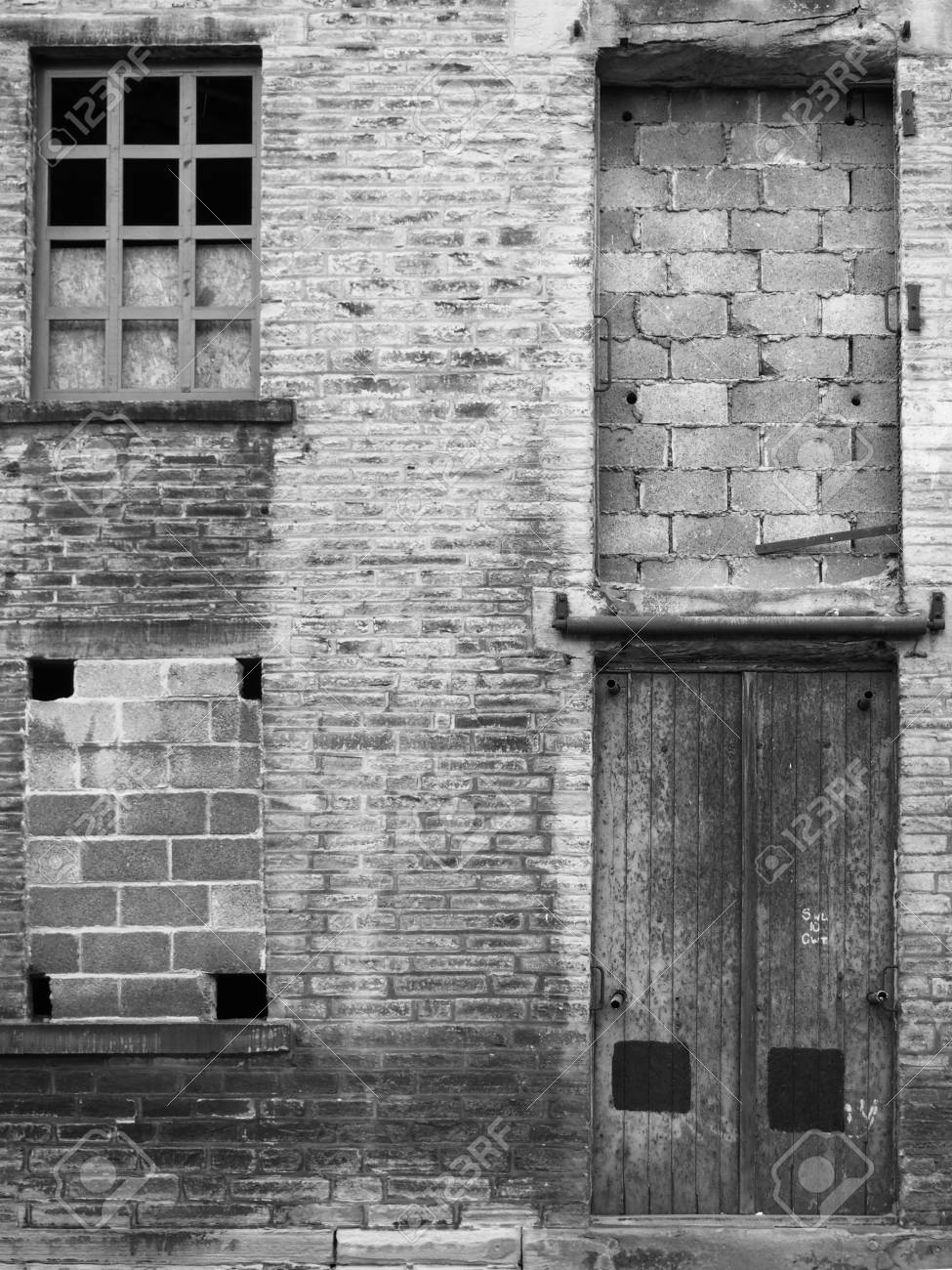 Abandoned Industrial Warehouse Building With Bricked Up Windows And Locked  Door In Halifax Yorkshire Stock Photo