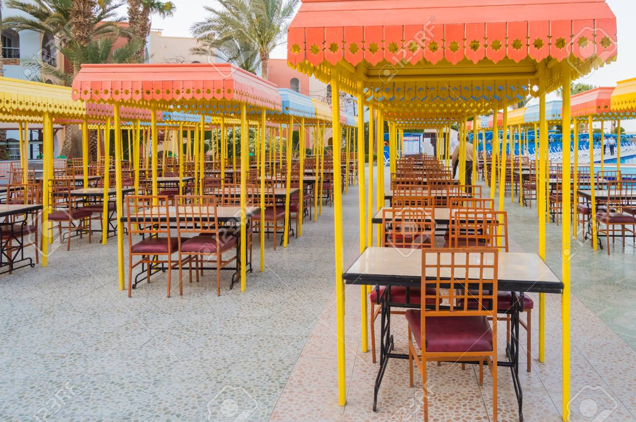 Outdoor Wooden Restaurant Terrace With Tables With Four Seats Stock Photo Picture And Royalty Free Image Image 121305254