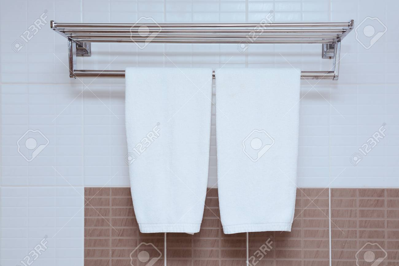hanging white towel. Stock Photo - White Towel Hanging On Bathroom Wall With H