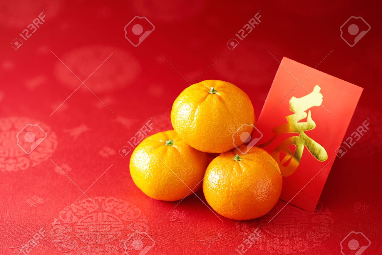 Chinese New Year - Mandarin orange and red packet (Foreign text means spring season) - 50801877