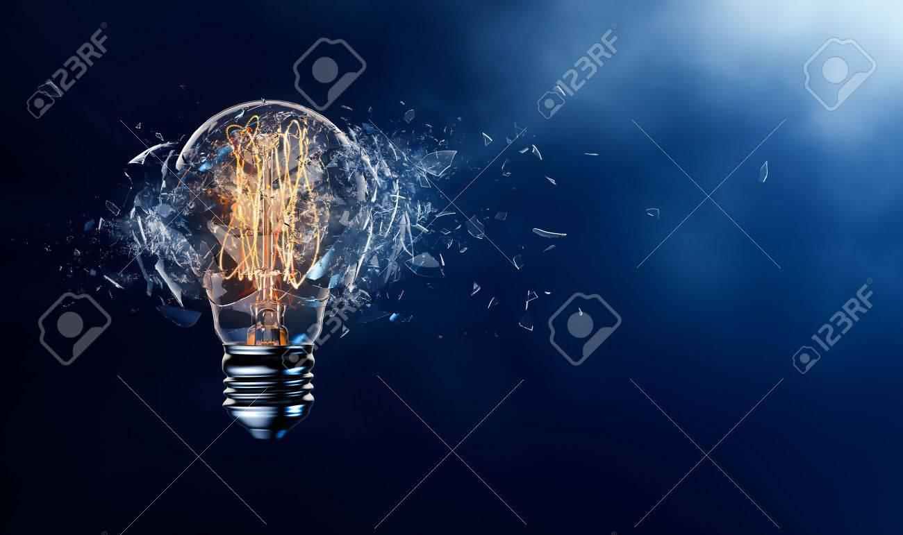Exploding light bulb on a blue background - 57132202