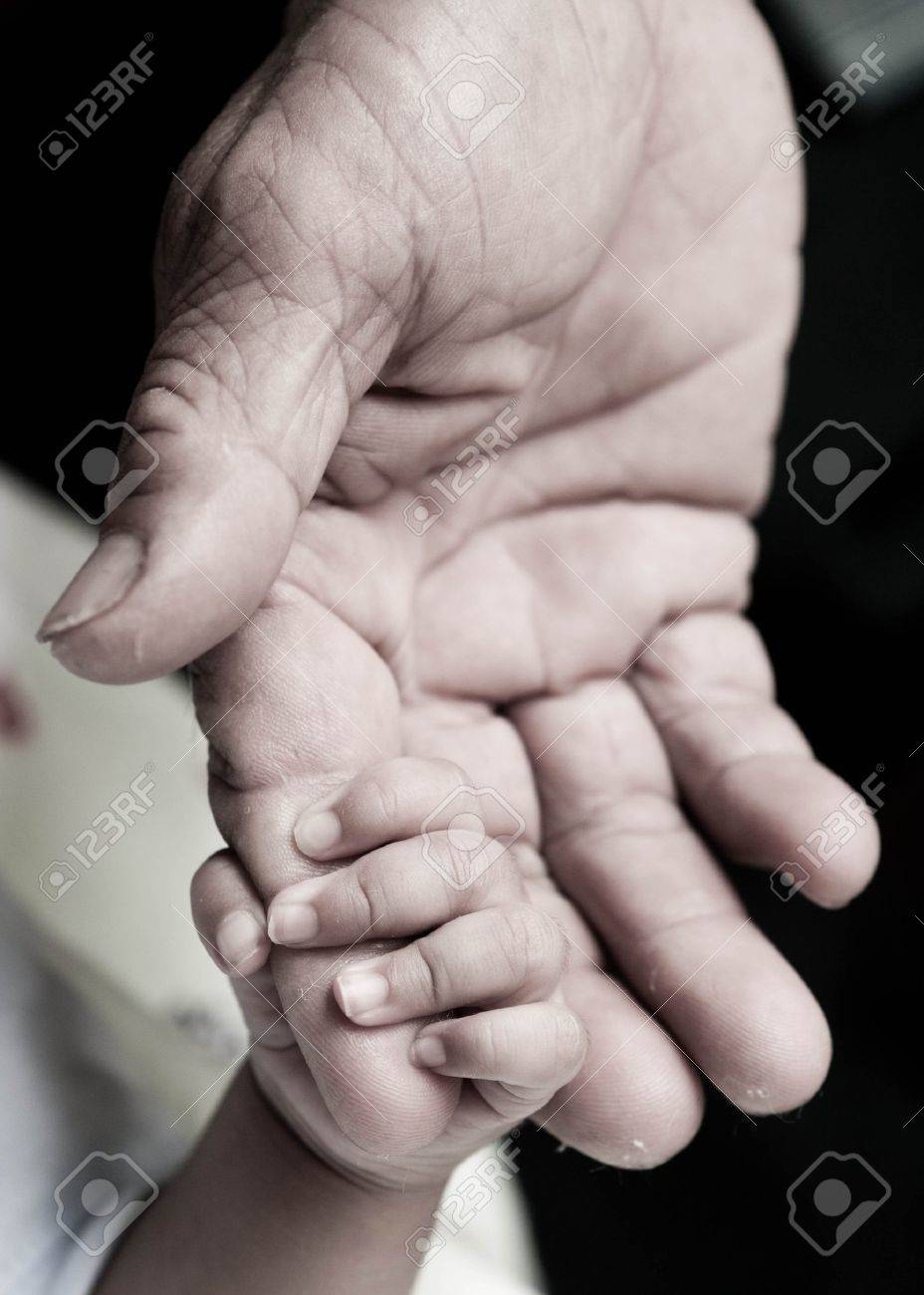 baby hand holding Rough finger - 11368262