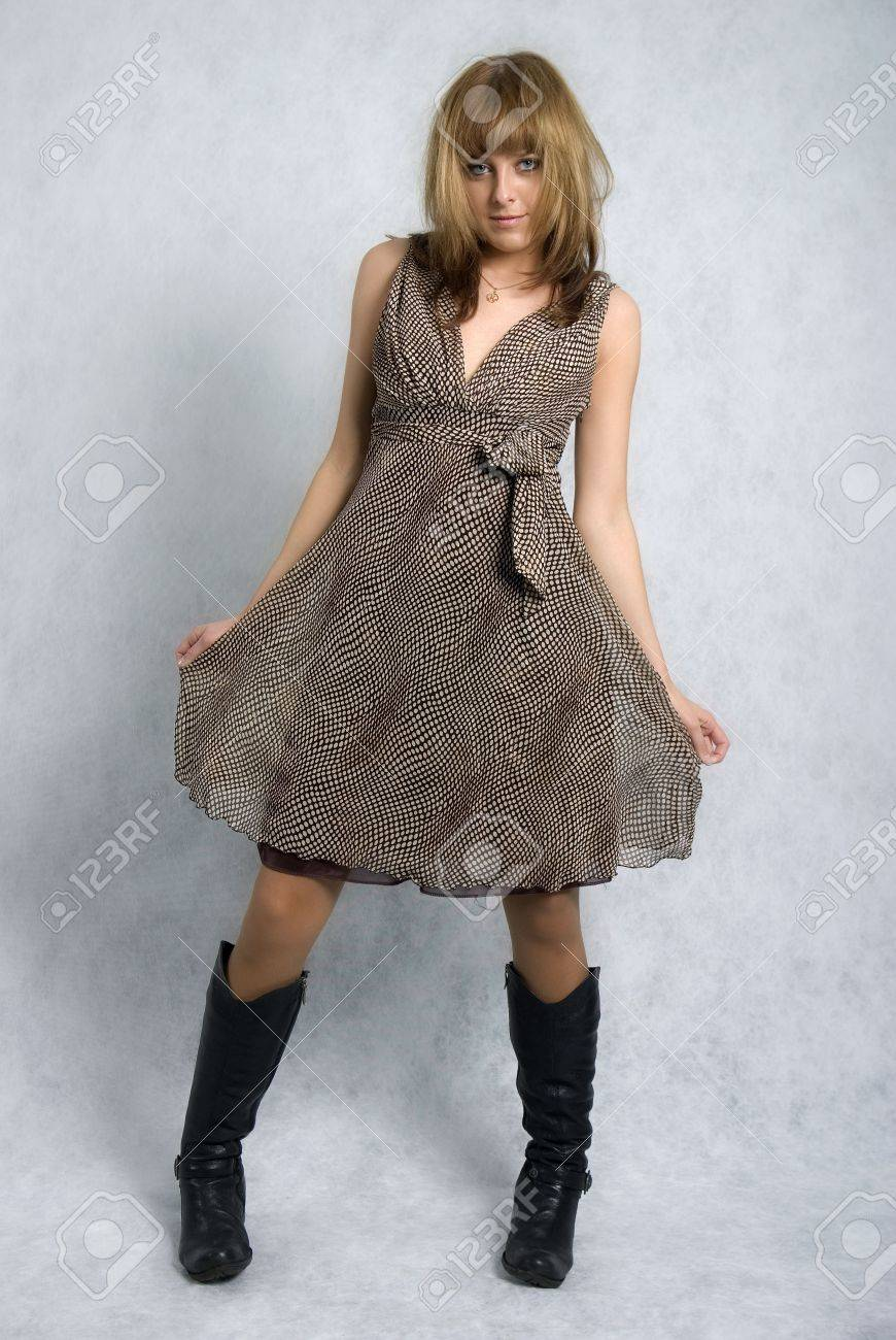 Stylish Girl In A Brown Dress And Black Boots Stock Photo, Picture ...