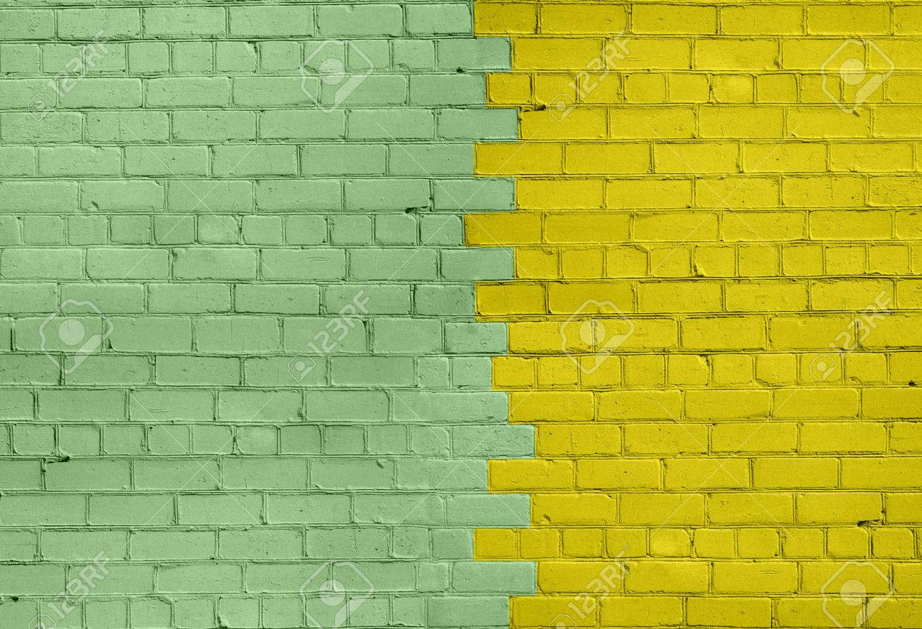 Brick Wall In Light Green And Dark Yellow Colors Divided On Two ...