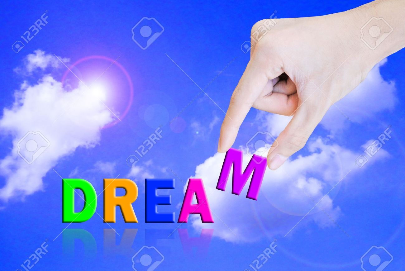 Hand pick and lift button dream word Stock Photo - 10712430