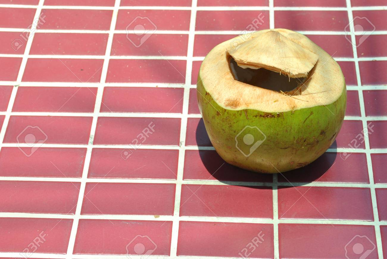 Coconut beverage is on beautiful sand land Stock Photo - 13452245