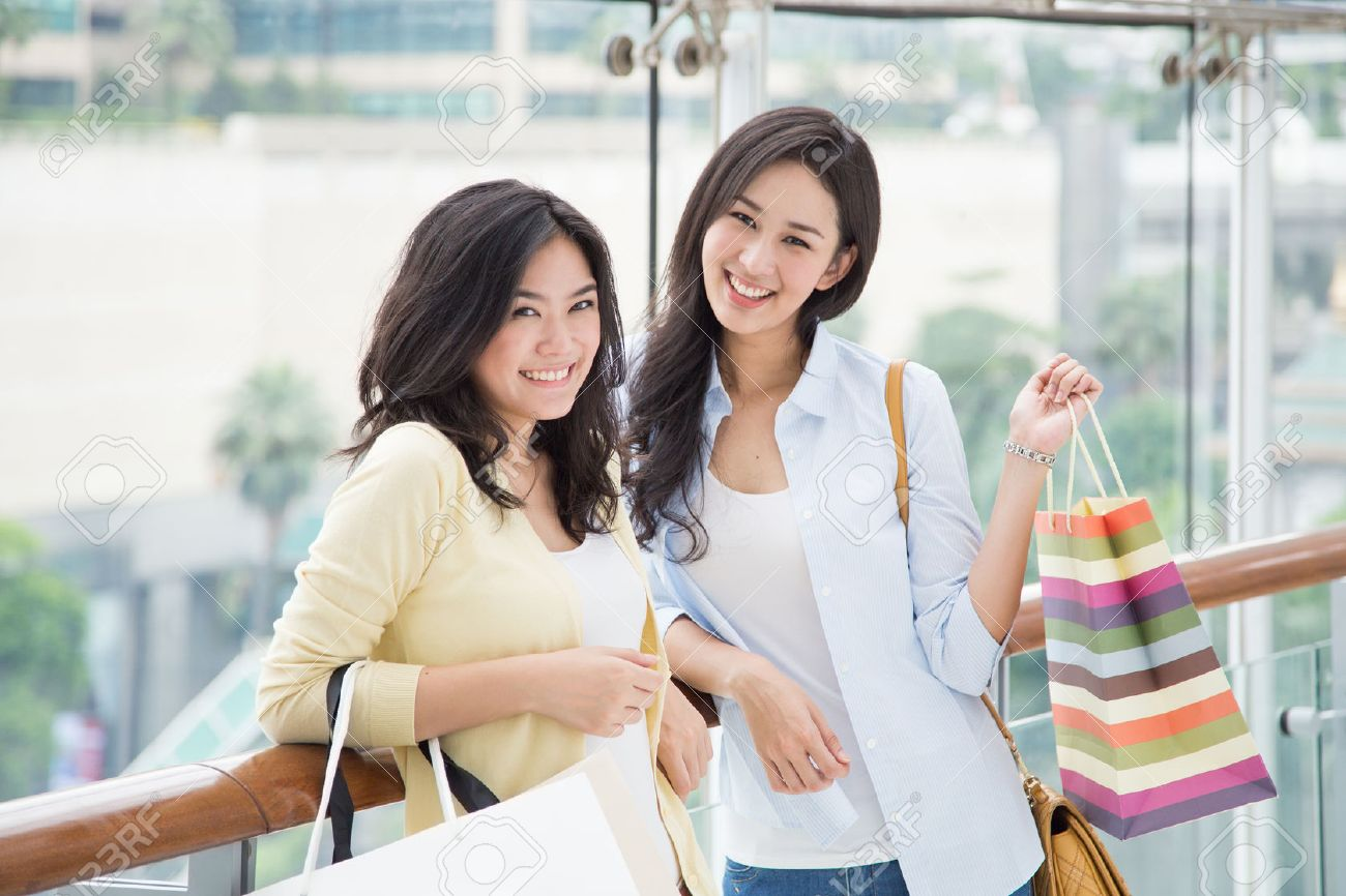 Stock Photo - Two asian women enjoy shopping