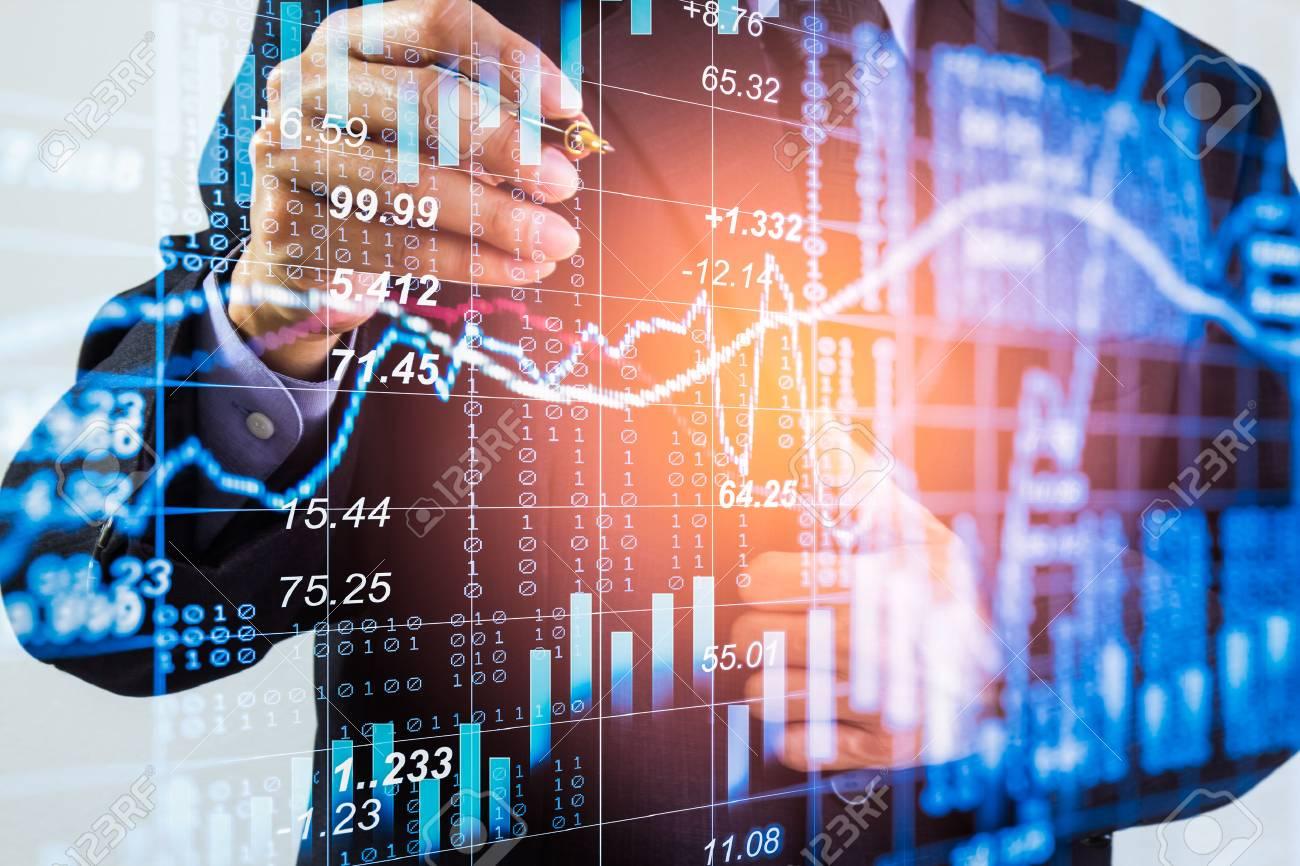 Business man on stock market financial trade indicator background. Man analysis stock market financial trade indices on LED. Double exposure of business man trade on stock market financial concept. - 87544944