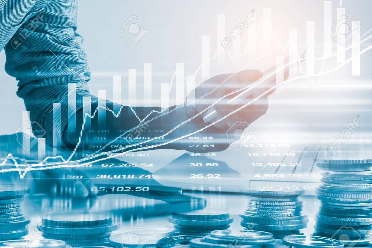 Business man on stock market financial trade indicator background. Man analysis stock market financial trade indices on LED. Double exposure of business man trade on stock market financial concept. - 93249563