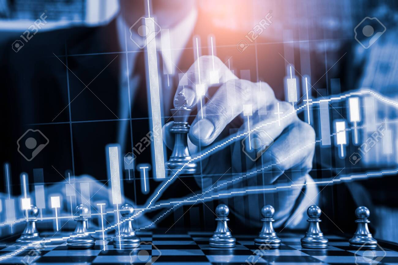 Chess game on chess board on stock market or forex trading graph chart for financial investment concept. Economy trends for digital business marketing strategy analysis. Abstract finance background. - 145764745