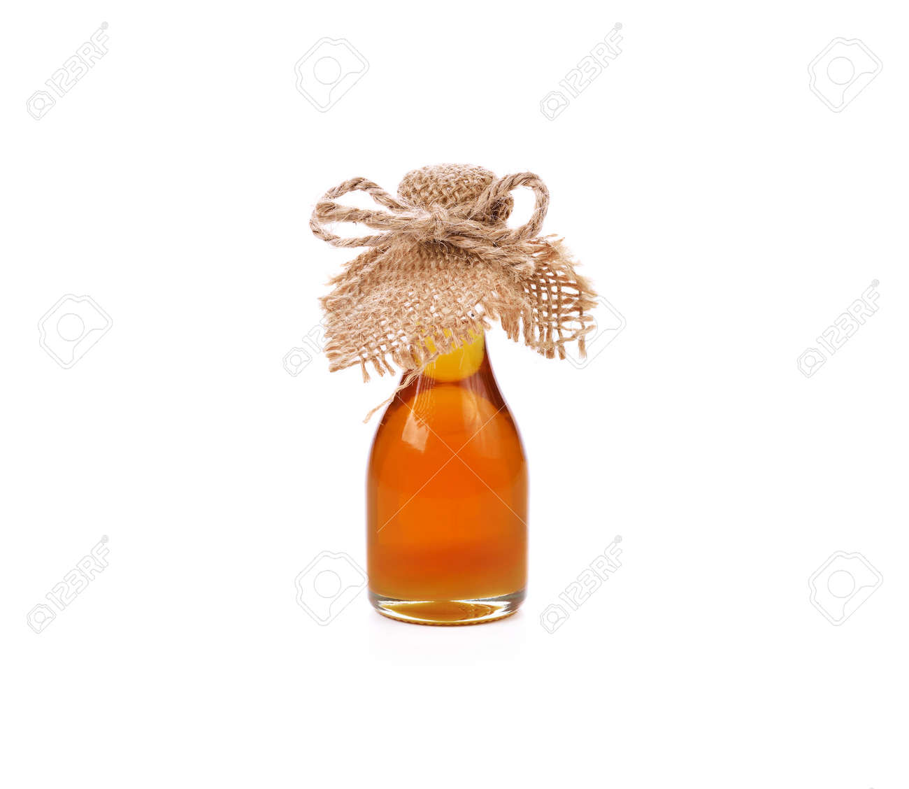 Honey and wooden dipper isolated on white background - 169847847