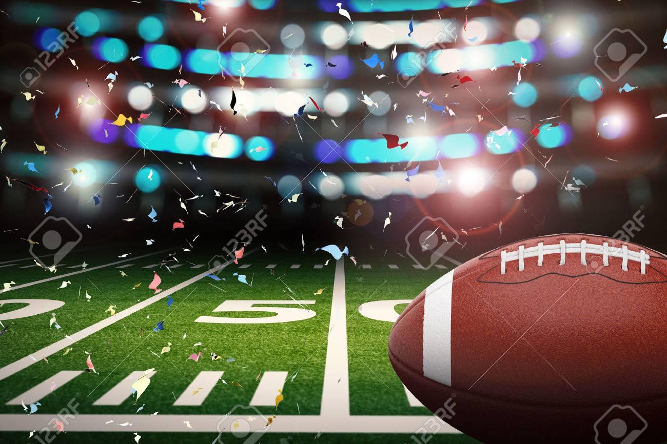 Foto de archivo - Representación 3D balón de fútbol americano con el brillo  de la luz y el fondo del confeti 849b59a45eae0