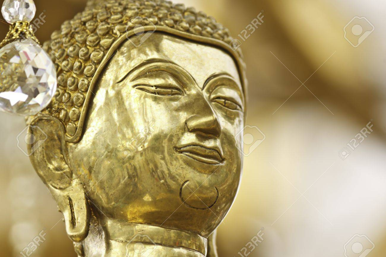face of Buddha statue in thailand - 21935322