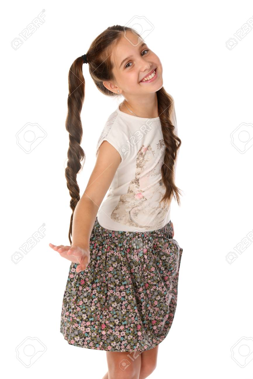 Portrait of a little girl 12 years old in summer clothes. Charming pretty  young teenager