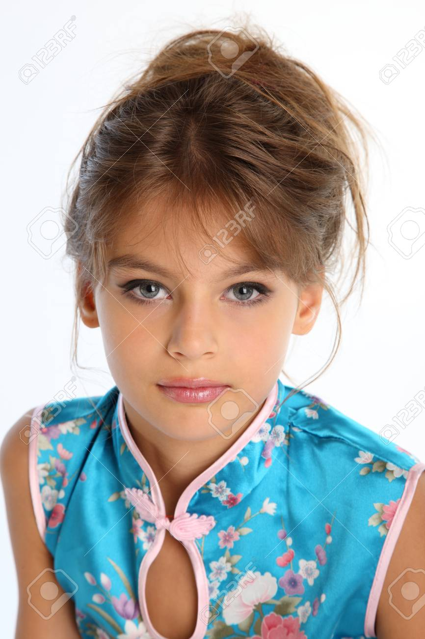 Close Up Portrait Of A Beautiful Girl In An Asian Blue Dress