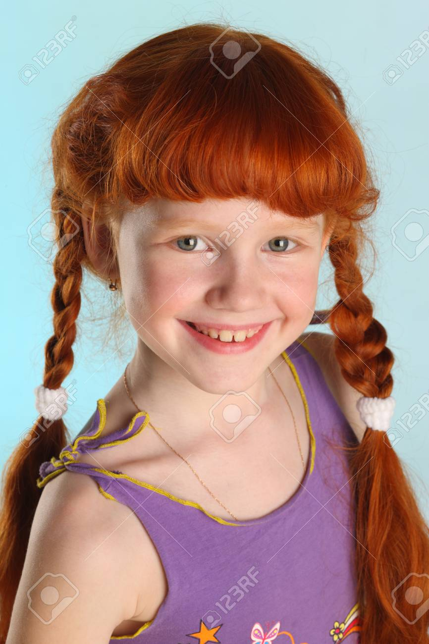 Close Up Portrait Of Beautiful Charming Little Redhead Girl Happy Attractive Child Posing In
